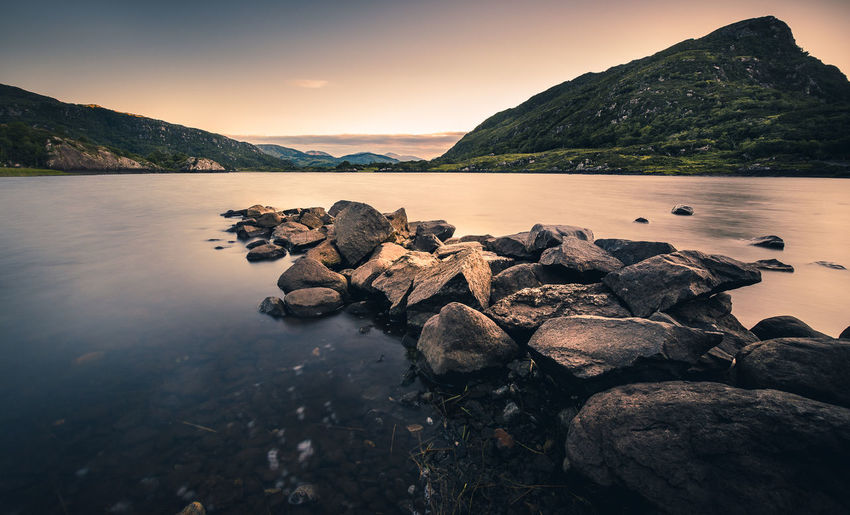 Ireland Beauty In Nature Idyllic Long Exposure Mountain Mountain Range Nature No People Non-urban Scene Outdoors Ring Of Kerry Rock Rock - Object Rocky Coastline Scenics - Nature Sea Sky Solid Sunset Tranquil Scene Tranquility Water The Traveler - 2018 EyeEm Awards
