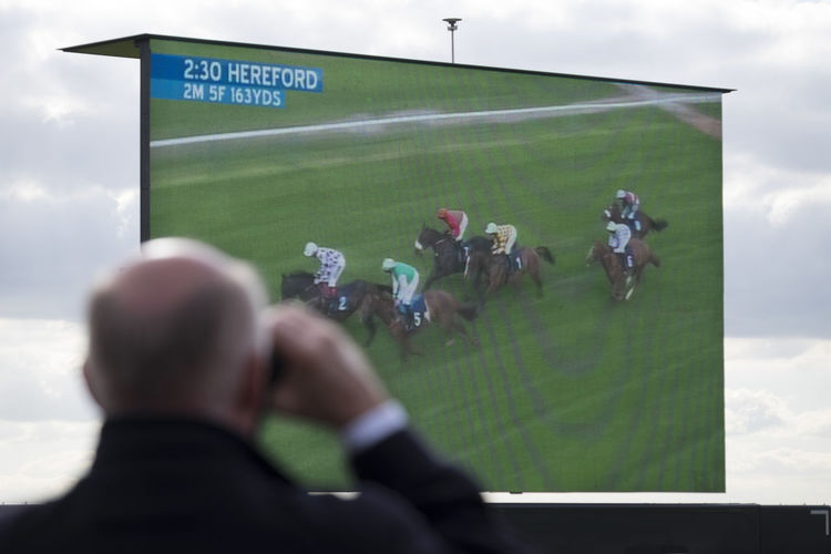 Spectator next to video wall Big Screen Binoculars Horse Race Horse Races Horse Racing Lifestyles Sport Video Wall