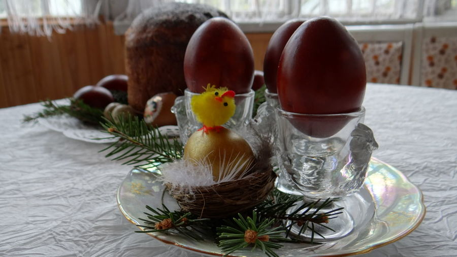 Close-Up Of Easter Eggs In Eggcups On Table
