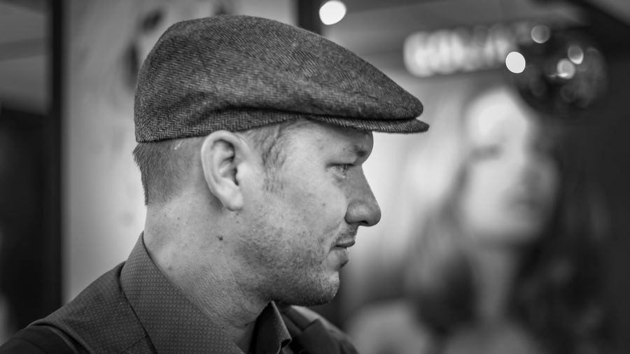 Side view of man wearing flat cap