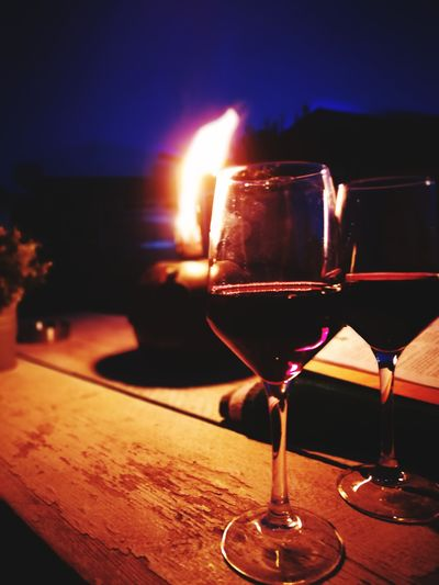 Romantic evenings ♥ EyeEm Selects EyeEmNewHere Ocean Vibes Wineglass Alcohol Drink Wine Cocktail Illuminated Drinking Glass Table Red Wine Martini HUAWEI Photo Award: After Dark