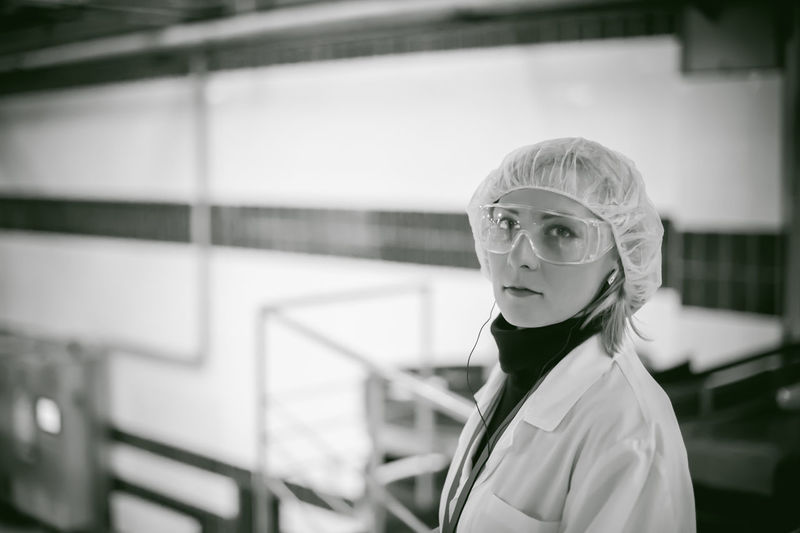 Portrait Of Female Doctor Wearing Protective Eyewear While Working At Hospital