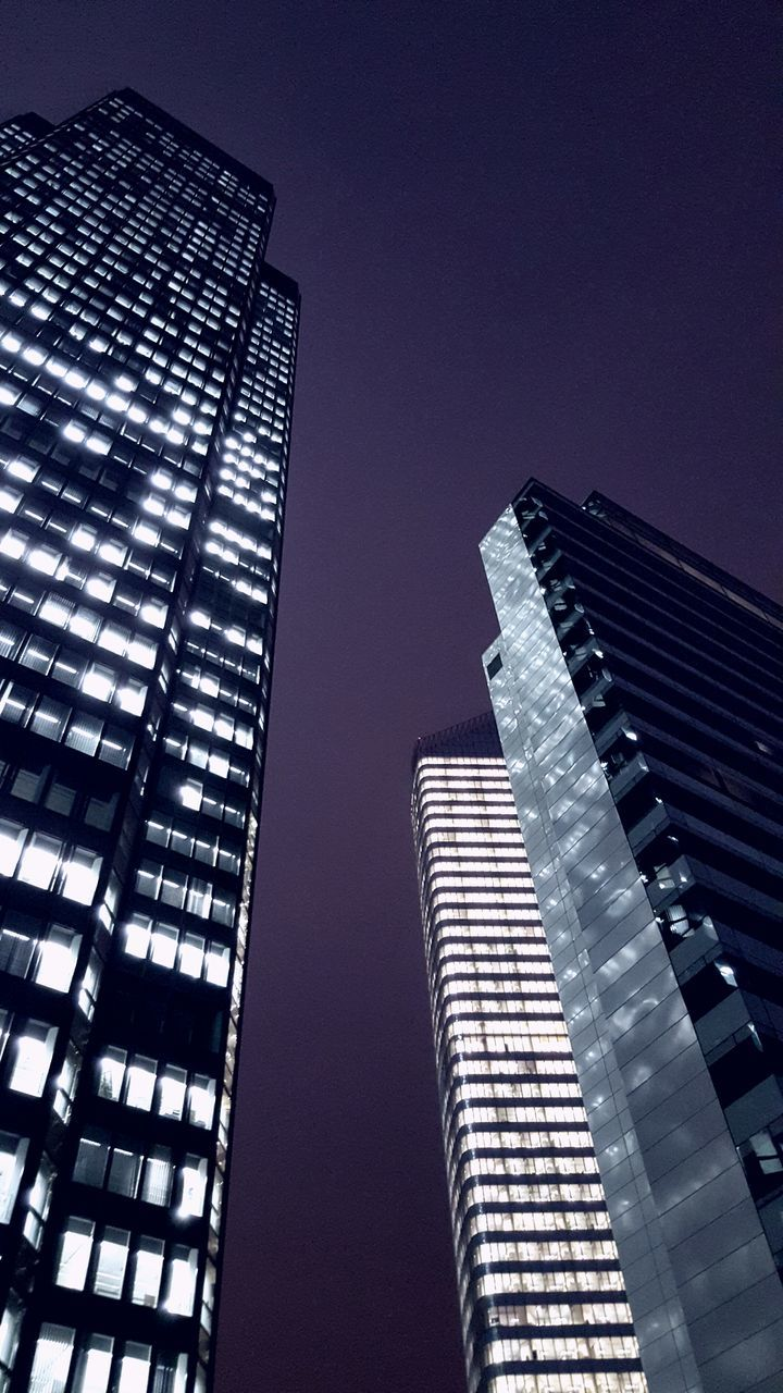 architecture, skyscraper, low angle view, modern, built structure, building exterior, tower, city, tall, clear sky, sky, outdoors, no people, illuminated, day