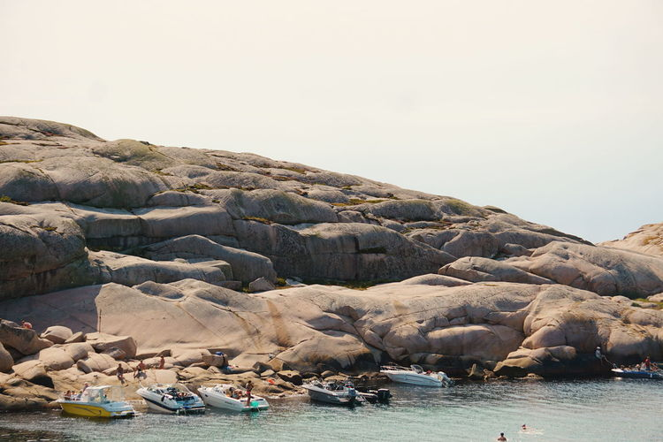 the marble rocks of Hållö Summer Sunbathing People Tourist Attraction  Tourist Destination Travel Destinations EyeEm Selects Water Sea Nautical Vessel Beach Rock - Object Sky Geology Rock Formation Cliff Rocky Mountains Rugged Stack Rock Rock Sandstone Rocky Coastline Coastal Feature Physical Geography Eroded