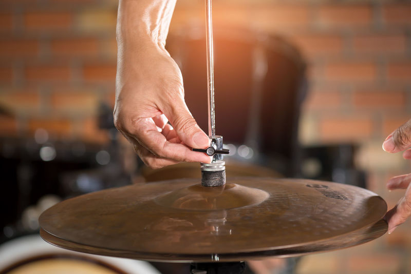 Drumkit ,Hihat adjusting. Close-up Day Drumkit Drummer Focus On Foreground Hihat Holding Human Body Part Human Hand Indoors  Men Occupation One Person People Real People Working Workshop