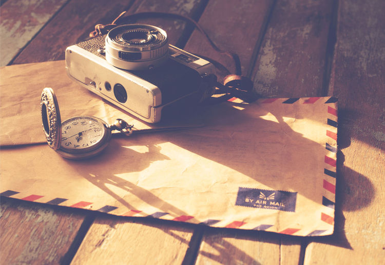 Vintage travel background, old film camera ,antique watches and airmail letter on wood table, instagram effect filter Table No People Technology Paper Equipment Communication Retro Styled Day Photography Themes Toy Flooring Antique Creativity Camera Film Watches Letter Vintage Retro Nastalgia Memories Remembrance Former