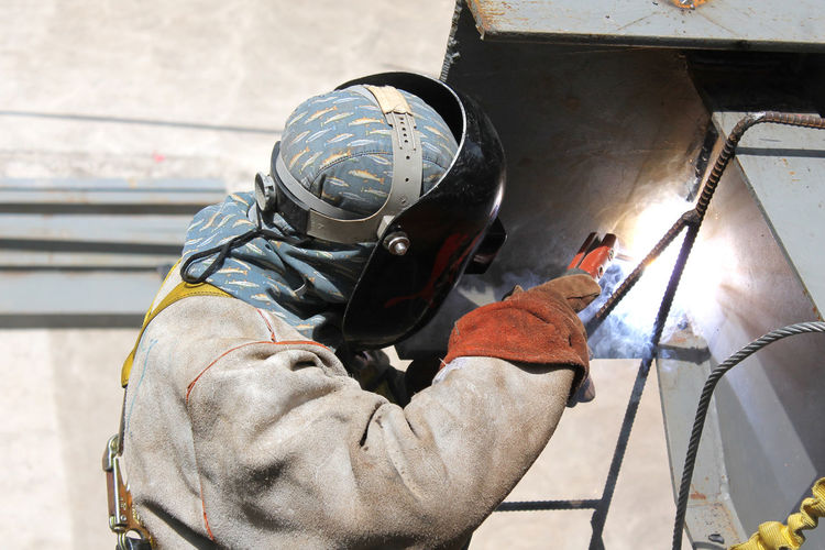 Welder working at construction site