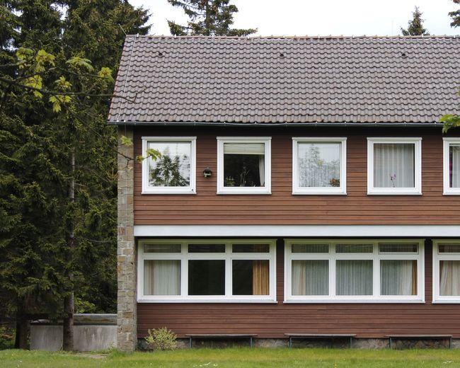 Windows of house against sky