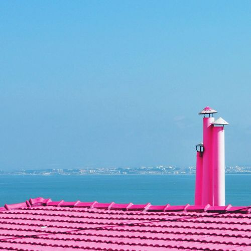 Pink Roof And Smoke Stack