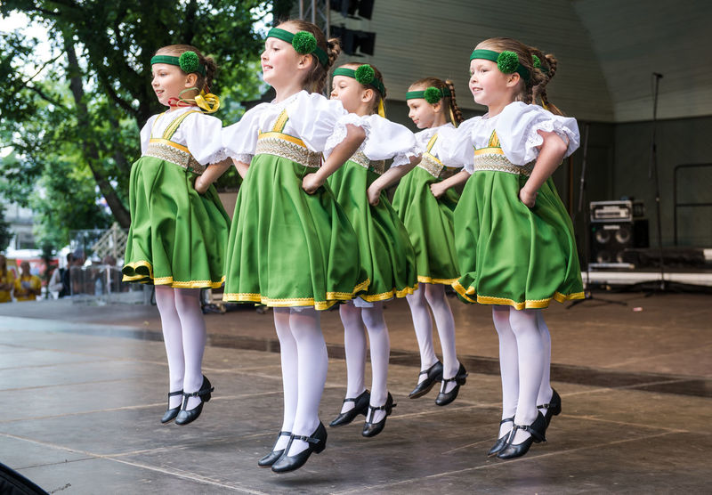 RIGA, LATVIA - JULY 03: Dancing childrens in national costumes at the Latvian National Song and Dance Festival on July 03, 2013. Holiday was hold from 30th June 2013 till the 7th July 2013. The Song and Dance Celebration has also been included in the UNESCO List of the Intangible Cultural Heritage of Humanity Artist Children Dancing Event Holiday Latvia Latvian National Song And Dance Festival Song And Dance Festival Summertime Capital Cities  Cultural Cultural Art Cultural Dance Culture Europe Festival Folk Human Latvian Northern Europe Outdoors People Riga Summer Unesco