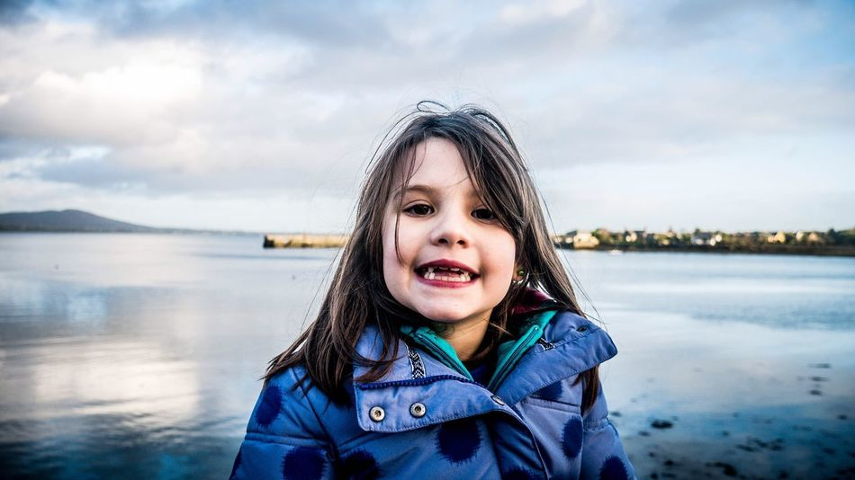 Winter sea portrait - Portrait Looking At Camera Focus On Foreground Sky Headshot Smiling Front View One Person Happiness Close-up Outdoors Childhood Cloud - Sky Real People Water Day Warm Clothing Nature People Kid Kidsphotography Ireland Sea And Sky