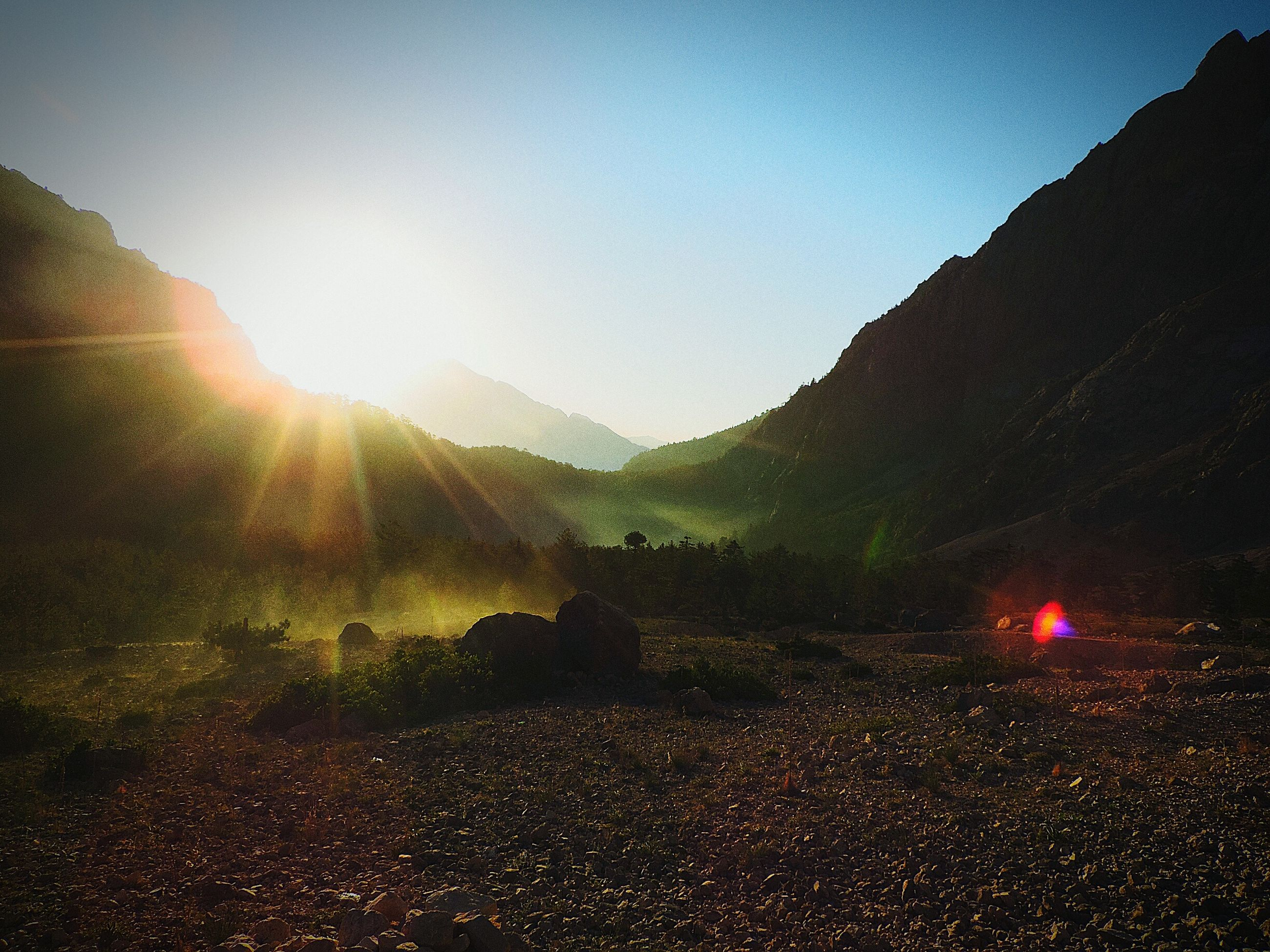 mountain, sun, tranquility, tranquil scene, clear sky, scenics, lens flare, mountain range, landscape, sunlight, beauty in nature, sunbeam, nature, sunset, silhouette, non-urban scene, idyllic, sky, copy space, remote