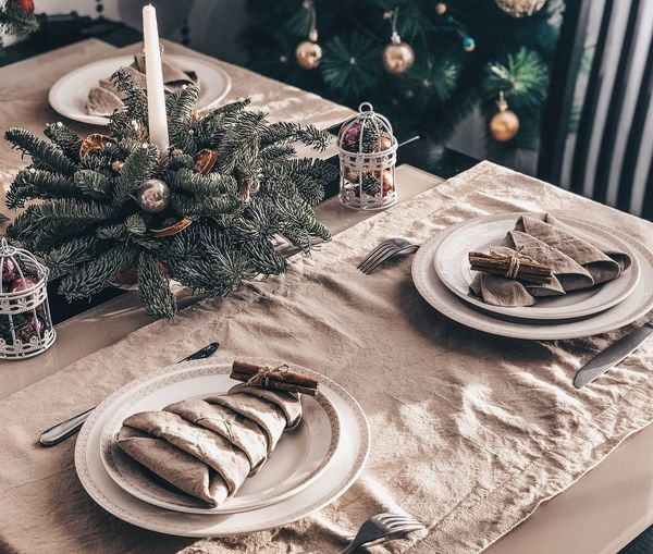 High angle view of dining table decorated at home during christmas