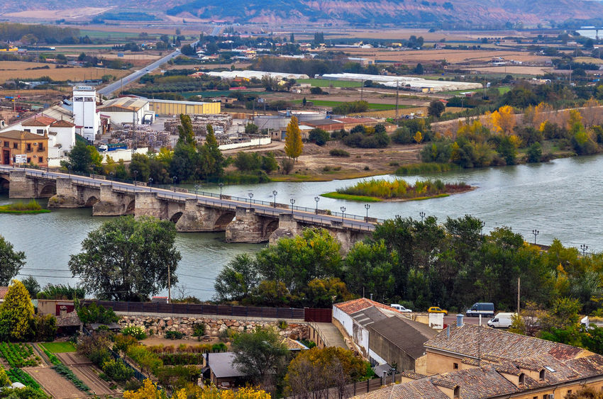 Cityscape of Tudela, Spain Cityscape Tudela SPAIN Landscape Bridge Stone Bridge High Angle View Outdoors No People Cityscape Day Architecture Building Exterior Water Built Structure Mountain Nature City Sky Tree
