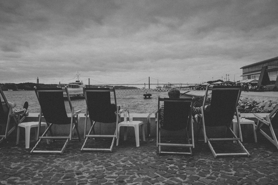 Architecture Beach Black And White Bridge - Man Made Structure Chair City Life Cloud - Sky Day Deckchair Enjoying The View Outdoors People Sitting Sky Streets Summer View Point