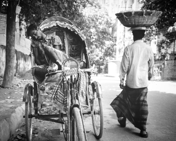 Enjoy The New Normal My Year My View Black And White Black & White Monochrome Street Photography Streetphotography Bicycle Real People Dhaka DhakaStreets Rickshaw Filmisnotdead Film Photography Filmphotography Film135 Transportation Kodak Kodak Film Blackandwhite Bangladesh Mood Moodygrams Nap Time Adventures In The City The Street Photographer - 2018 EyeEm Awards The Traveler - 2018 EyeEm Awards The Photojournalist - 2018 EyeEm Awards #urbanana: The Urban Playground Urban Fashion Jungle A New Beginning