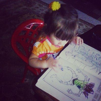 Look who discovered crayons and coloring books! I think I have another little artist on my hands.