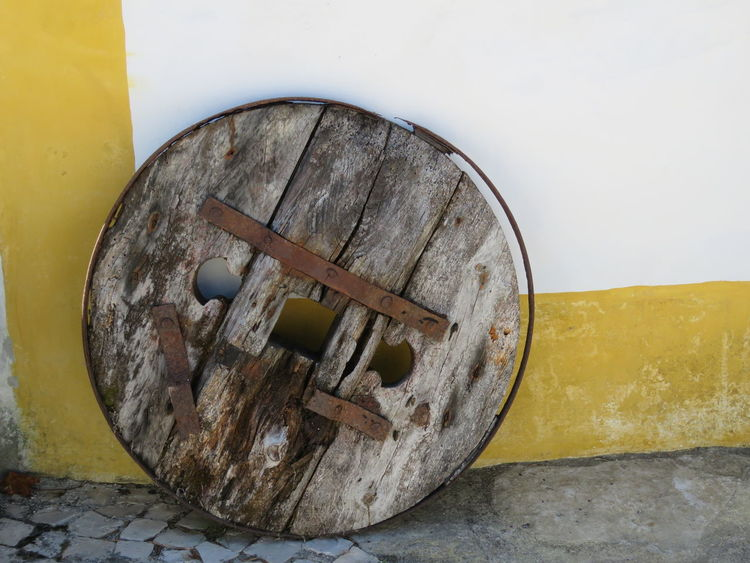 Cart Wheel Cobblestone Streets Rust Wheel Wood Close-up Cobblestone Cobblestones Corner Day Freshness Metal No People Old Old Buildings Old House Old Metal Old Wheel Outdoors Round Rusted Rusted Metal  Wood - Material Yellow Yellow Color Paint The Town Yellow The Week On EyeEm