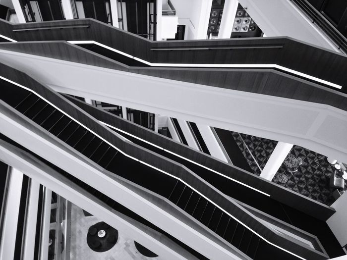 stairways... Architecture_collection Bnw Architecture Blackandwhite Photography Blackandwhite Architecture Built Structure Building Exterior High Angle View Staircase Railing Steps And Staircases No People Building Modern City Moving Up