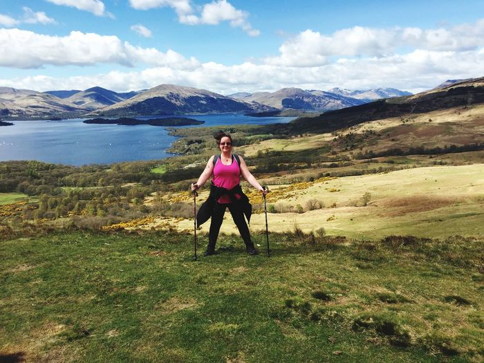 Happy Woman Standing With Hiking Pole On Conic Hill