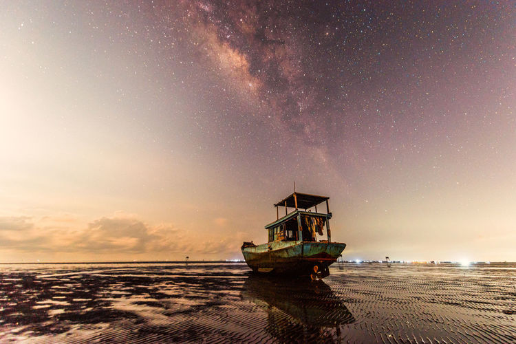 Lonely ship under the Milky Way Galaxy on the night sky Sky Water Scenics - Nature Sea Beach Beauty In Nature Land Nautical Vessel Horizon Nature Horizon Over Water Star - Space Tranquil Scene Astronomy Tranquility Night Sunset No People Outdoors Milky Way Lonely Boat Rural Scene Alone Galaxy