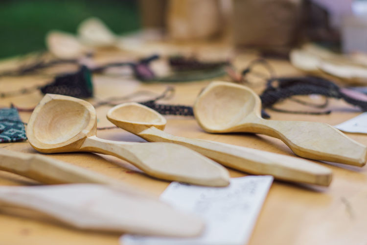 Close-Up Of Wooden Spoons On Table