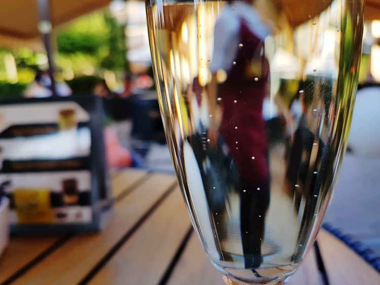 Drink Drinking Glass Food And Drink Table City Mix Yourself A Good Time The Week On EyeEm EyeEmNewHere Prosecco Bubbles Bubbles In Glass Reflection People Reflections Woman Reflected Leisure Activity Relaxing Drinking Lifestyle Paint The Town Yellow Rethink Things Stories From The City