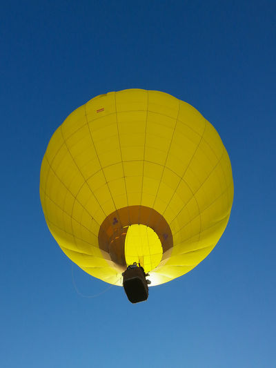 Traffic Trip Adventure Air Vehicle Balloon Blue Blue Sky Clear Sky Cloudless Cloudless Sky Colorful Day Extreme Sports Floating In The Air Freedom Hot Air Balloon Midair Outdoors Recreational Pursuit Sky Slow Traffic Slow Transportation Sport Transportation Yellow