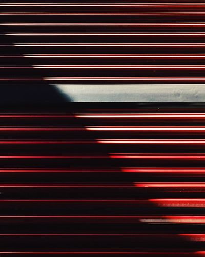 Close-Up Of Red Blinds