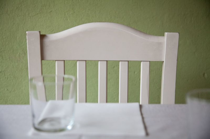 Happy white chair near table Wooden Wall Table Empty Chair Empty Glasses Dinner Country House Country Life Lifestyle Country Tavern  Table No People Nobody Restaurant Food And Drink Seat No People Chair Absence White Color Empty Wood - Material Day Green Color Outdoors Furniture Textile Simplicity