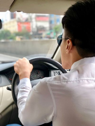 Asian man driving car Mode Of Transportation Motor Vehicle Car Men Transportation Vehicle Interior Rear View Males  Car Interior Driving Adult People Land Vehicle Indoors  Travel Business Lifestyles Young Men Portrait