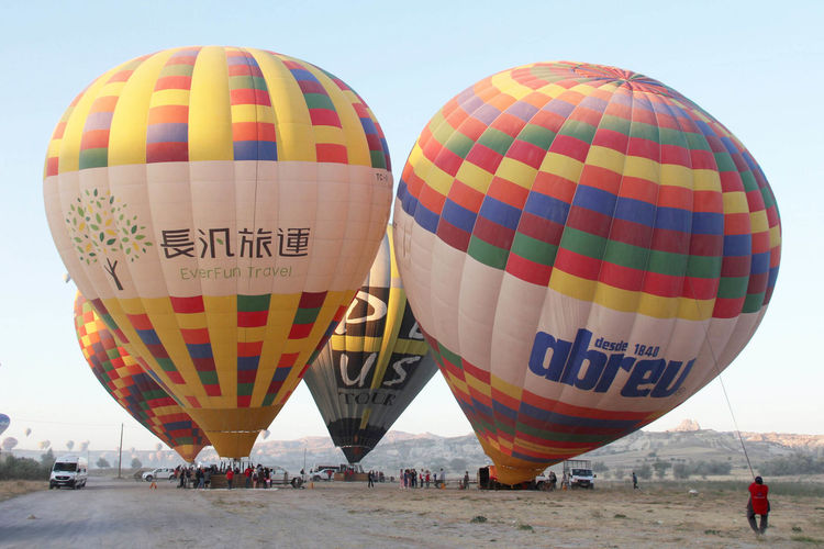 Hot Air Balloons Adventure Air Vehicle Balloon Ballooning Festival Day Flying Hot Air Balloon Incidental People Leisure Activity Mode Of Transportation Multi Colored Nature Outdoors Pattern Real People Sky Text Tourism Transportation Travel Travel Destinations