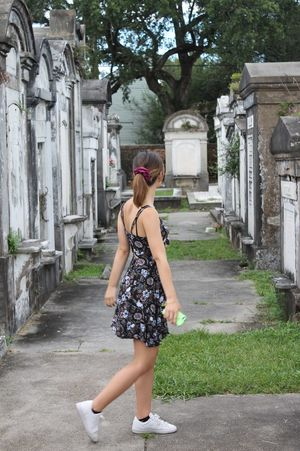 ...many have passed before us and have incredible stories to tell! One Person Leisure Activity Full Length Young Adult Day Real People Outdoors Lifestyles Standing Young Women Only Women Architecture One Woman Only Adults Only Adult People GraveTomb Death New Orleans Cemetery Cemetery Photography EyeEm Selects