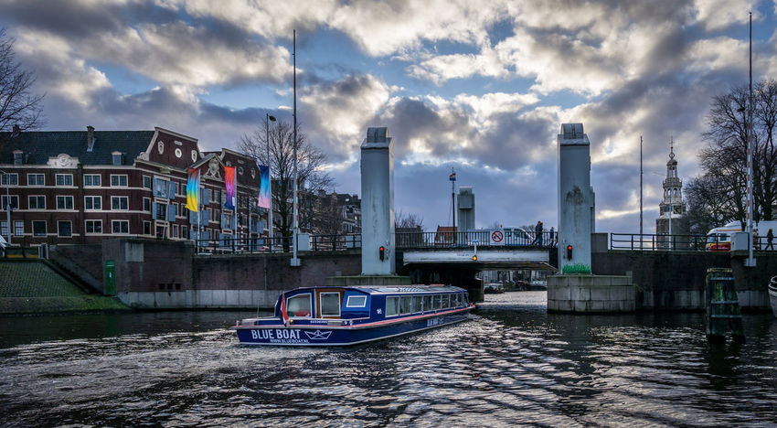 seen on a canal cruise in Amsterdam Amsterdam Christmas Dramatic Sky Europe Trip Netherlands Noordwijk Rotterdam Tourist Attraction  Winter Canal Canals And Waterways Cloads Destination Europe Gracht Ship Tourism Tourist Destination