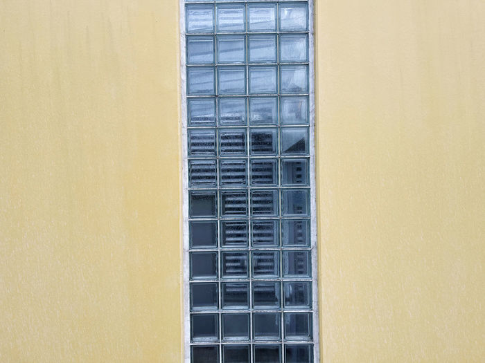Low angle view of yellow window on building