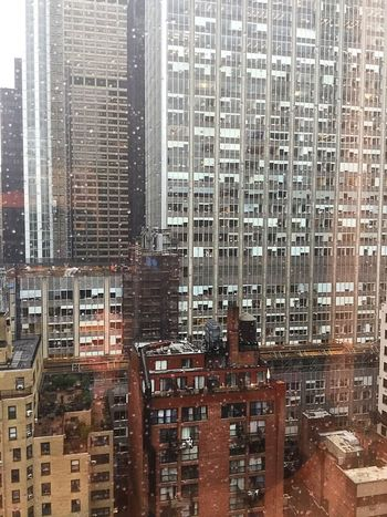 Manhattan rain buildings New York City architecture
