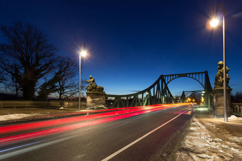 Berlin Glienicker Brücke Potsdam Blurred Motion City Clear Sky Glienicke Bridge High Street Illuminated Lens Flare Light Trail Long Exposure Motion Night Nightshot#night No People Outdoors Road Sky Speed Street Light Transportation