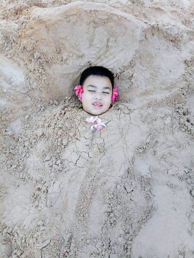 Child Childhood Children Only One Person Flower High Angle View Black Hair Girls Looking At Camera Headshot Day One Girl Only Sand People Portrait Pink Color Outdoors Nature Beach EyeEm Selects Investing In Quality Of Life