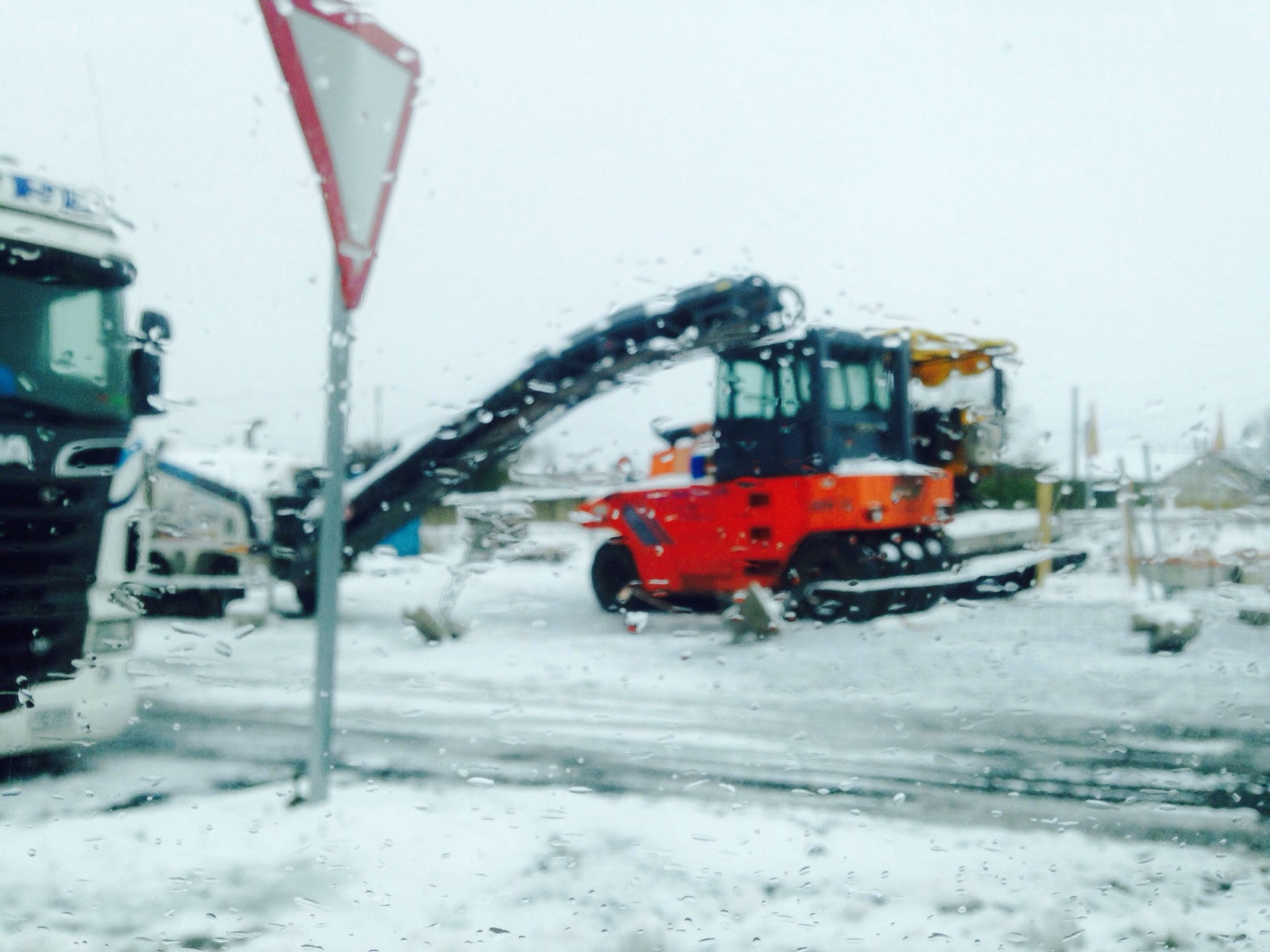 snow, winter, cold temperature, season, weather, transportation, mode of transport, land vehicle, covering, car, frozen, covered, public transportation, white color, building exterior, road, train - vehicle, built structure, architecture, snowing