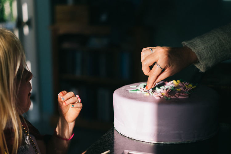 Sneaking a piece Birthday Dessert Eating Females Food Indoors  Light And Shadow Little Girl Painted Nails Purple Sweet Food Togetherness Two People
