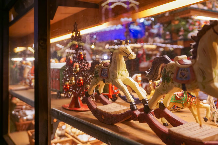 Christmas market nostalgic toys in a store window Business Children Christmas Christmas Assortment Christmas Fair Christmas Market Lights Toys Advent Season Bokeh Booth Carousel Horses Christmas Tree Enjoyment Evening Focus In Foreground Historically Illuminated Night No People Old Rocking Horse Romantically Store Window Trade