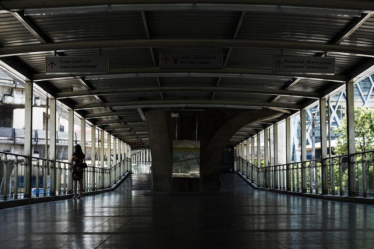 People walking on elevated walkway
