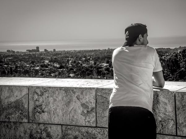 At the Getty museum...... Lgarciaphoto IPhone Photography IPhone IPhoneography IPhone 7 Plus Iphonephotography Iphoneonly Shot On IPhone Getty The Getty Center Museum Rear View Real People Three Quarter Length Standing Lifestyles One Person Leisure Activity Day Outdoors Sky Cityscape Water Black And White Bnw
