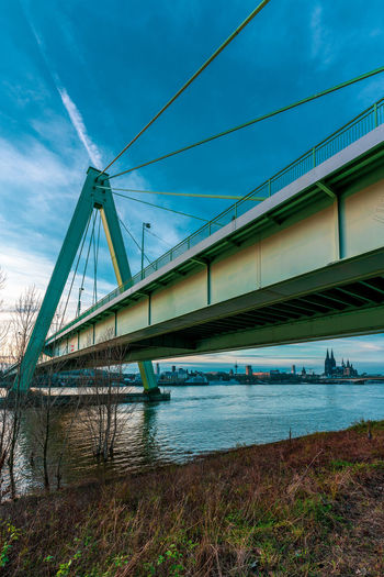 Low angle view of bridge over calm river