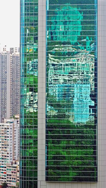 Adapted To The City Building Exterior Architecture City Skyscraper Cityscape Day Urban Skyline Glass Reflection Glass Wall Trees Tree Reflections