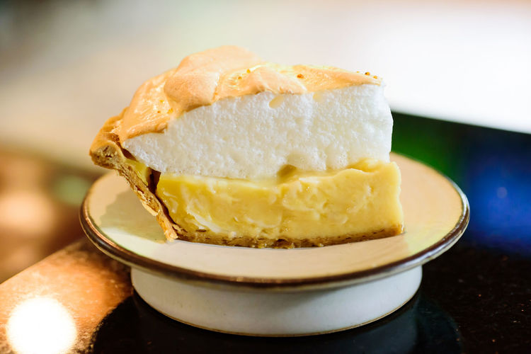 Piece of lemon meringue pie on white dish Bakery Cake Close Up Coconut Cream Cuisine Culinary Delicious Dessert Dish Eating Food Fresh Gourmet Juicy Meringue Pie Piece Sweet Tart Tasty Yellow Food And Drink Sweet Food Ready-to-eat Indoors  Serving Size