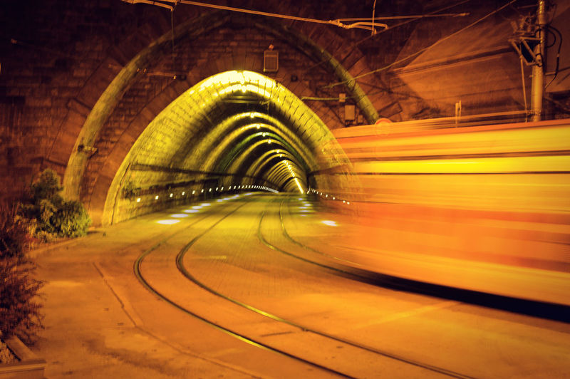 The light at the end of the tunnel is a train Bratislava, Slovakia Arch Architecture Blurred Motion Bratislava Built Structure City Curve Diminishing Perspective Direction Illuminated Light Light Trail Long Exposure Motion Night No People Road Speed The Way Forward Train Tramway Transportation Tunnel The Street Photographer - 2018 EyeEm Awards EyeEmNewHere