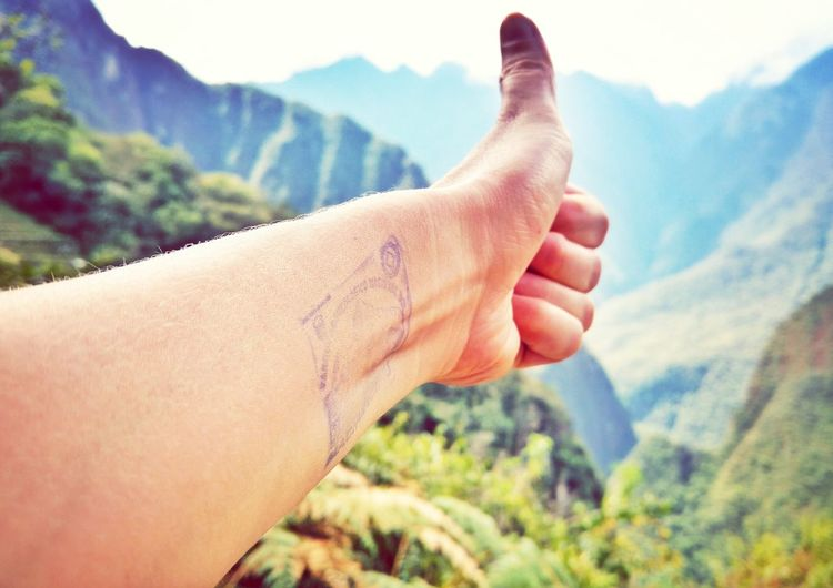 Thumbs up with Machu Picchu tattooEyeEm Selects Human Body Part Human Hand Mountain People Adult One Person Close-up Outdoors Nature Mountain Range Day Lifestyles Tattoo Machu Picchu Peru Beauty In Nature Adults Only Only Women Sky Politics And Government First Eyeem Photo