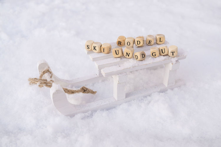 Holiday Sledge Sleigh Snow ❄ Text Winter Winter Sport Wintersport Wintertime Close-up Cold Communication Day No People Outdoors Ski Snow Text White Background Winter Holidays