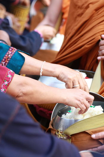 Midsection of woman holding food in container